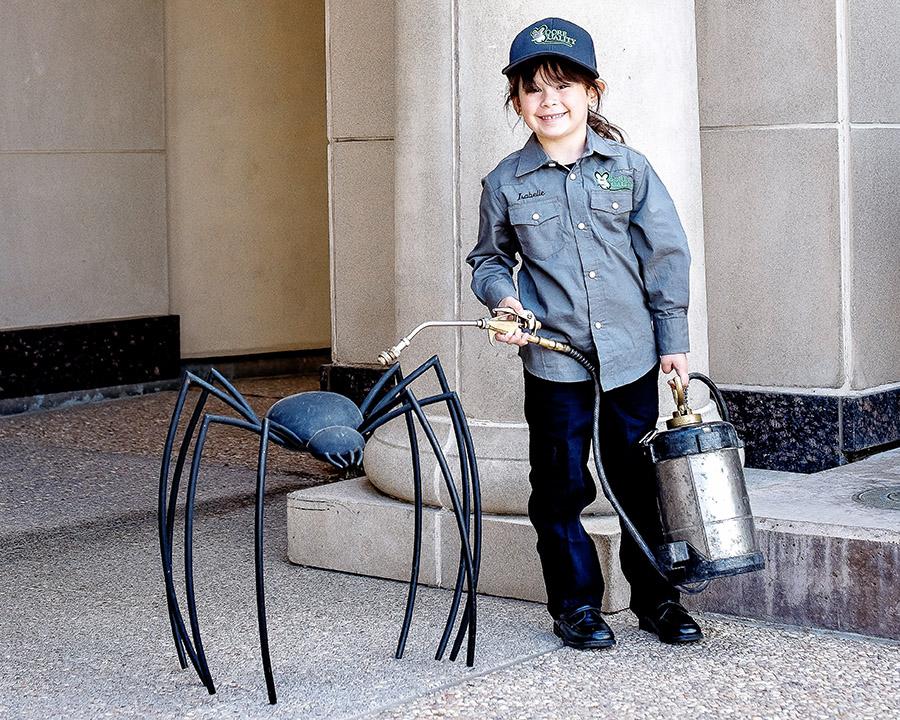 Moore Quality Pest Control child pretending to spray fake spider